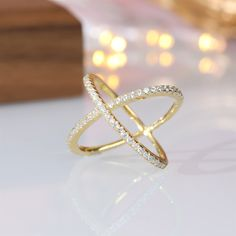 "This standard silver horizontal ring cubic zirconia wedding ring is made from 925 sterling silver and shiny white cut AAA cubic zirconia. The cross loop is one of the most popular rings of the year. The ring's exquisite sheen and simple, stylish ""X"" design are stunning and a symbol of eternal love. Gold Plated Rings, White Gold Rings, Womens Wedding Bands, Wedding Ring Bands, Cubic Zirconia Wedding Rings, Love Knot Ring, Tungsten Mens Rings, Great Gifts For Mom, Engagement Bands"