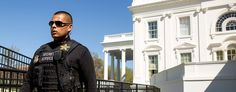 Officer stands on alert outside the White House after shots were fired in the U.S. Capitol Visitor Center. (AP)