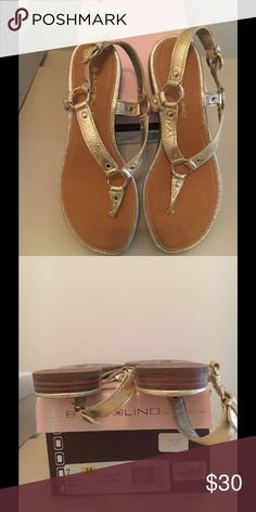 Bandolino Gold sandals Bandolino gold metallic sandals, very little miles on these babies. Really good condition. The wrinkle pattern look of the straps is constant and the sandal is made to look that way Bandolino Shoes Sandals