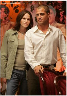 Jorja Fox and George Eads as Sara Sidle and Nick Stokes on CSI