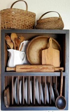 Primitive country kitchen, love old bread boards & love me some baskets plus mixed with white ceramics & its darling in my book