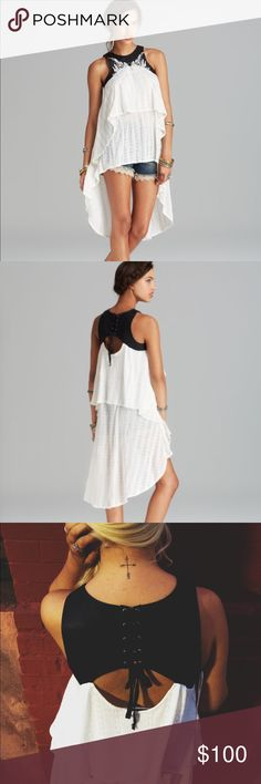 Free People Dark Night Tunic Top New! Free people dark night tunic. Amazing top that can be worn year round! Pair with shorts for a summer day, bandage skirt for night or skinny jeans in the colder months. Beautiful twirled white light knit with a faux leather embroidered lace up top. An embroidered, faux-leather yoke provides contrast on a layered, open-knit Free People tunic. A cutout and lace-up closure detail the back. Sleeveless. Size M, can fit variety of sizes! Free People Tops Tunics