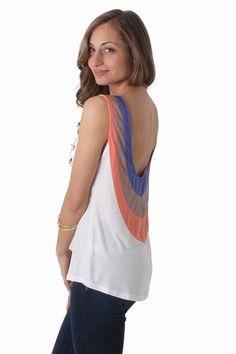 From street to sand this trendy tank will complete any weekend look. This soft knit tank features blue, orange and taupe panels making their way from the shoulders down a plunging low cut back for sexy, summery appeal. The relaxed fit of this tank makes it perfect for the next sunny day!