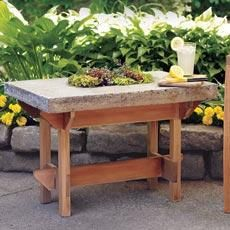 This handsome patio table has a hypertufa top. Made from a mix of cement, peat moss, and perlite, hypertufa has much of concrete's strength and durability, but it weighs a lot less, doesn't require sealing, and has a more textured, organic appearance. | Photo: Wendell T. Webber | thisoldhouse.com