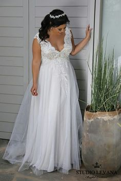V-neck lace and tulle plus size wedding dress. A real show stopper by Studio Levana