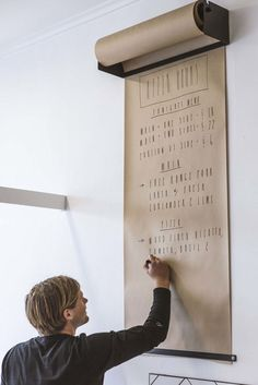 wall-mounted kraft paper roller from George & Willy in New Zealand | Remodelista