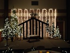DIY Christmas stable made using six foot fence panels for $35. Manger made out of free pallet. Ward Christmas party decorations.