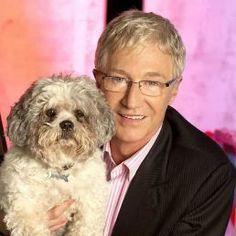 Born: June 1955 in Birkenhead ~ Paul James Michael O'Grady, MBE is an English comedian, television presenter, actor, writer and radio disc-jockey. Seen here with his beloved Buster. Partner: Andre Portasio Spouse: Teresa Fernandes (m. English Comedians, Battersea Dogs, Uk History, Dogs Trust, Tv Awards, Extraordinary People, Tv Presenters, Dog Show, Celebs