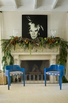 Love the fireplace arrangement of greenery (minus the very freaky canvas) :)