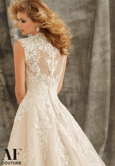 Bridal Gown 1344 Embroidered Appliques on Tulle Ball Gown with Wide Hemline Border