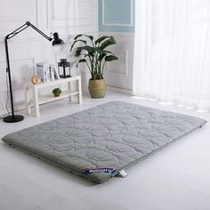 Check out this totally minimalist mattress idea with a Japanese futon mattress (shikibuton). Simple, lightweight and compact for any size bedroom. Decorate your room with this simple mattress and be amazed by the health and home benefits of having this minimal futon mattress.