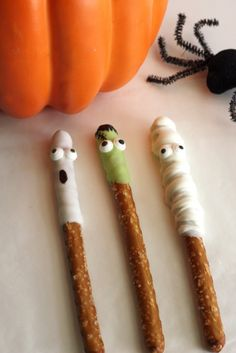 Halloween White Chocolate Covered Ghost and Frankenstein Pretzels | CatchMyParty.com