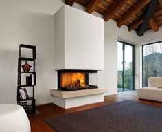 Are you looking for some amazing ideas for your new corner fireplace? Explore the top best corner fireplace designs featuring luxury angled interior ideas and inspiration. 3 Sided Fireplace, Fireplace Wall, Living Room With Fireplace, Fireplace Design, Fireplace Mantels, Fireplace Ideas, Simple Fireplace, Mantel Ideas, Installing A Fireplace