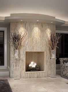 Fireplace wrapped in vertical stone - it's nearly like what I want to do...... imagine dark-gray ledger stone..... with lights like this on a trac