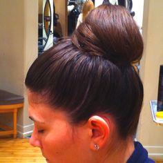 Top knot. High bun. Bridal Hair style. Wedding updo, Bride or bridesmaid hairstyle.