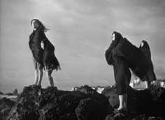 La terra trema, 1948, directed by Luchino Visconti. The women await the return of the fishermen lost in the storm.