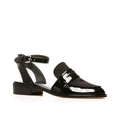 Make a statement in the reinvented penny loafer. Punchy in patent and far from proper, this distinctive silhouette is part loafer, part sandal and entirely covetable. Team with tailored trousers and a boxy shirt.   Adjustable ankle strap Heel measures approximately ¼ inch Available in black patent Leather insole Leather sole Made in Spain