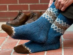 The different types of colors, textures and designs used in knitting socks vary, but you'll be completely satisfied with the sock knitting pattern, Border Socks by Mary Jane Mucklestone.