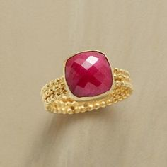 JESTER'S TOUCH RING Item No. 70490	$98.00 Harlequin facets and a bubbly three-ring band hint at levity without distracting from the beauty of a faceted ruby. Handcrafted in 22kt gold plated sterling silver. Whole sizes 5 to 10.