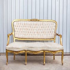 Goldie Settee: With an off-white and pale peach upholstery and a worn golden frame, Goldie adds an elegant touch to any event or photo shoot.