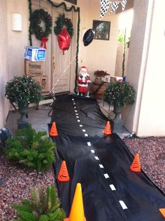 Cars Birthday Party Entrance! Black table runner, white tape and small orange cones!