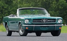 1964 Ford Mustang convertible. . . .