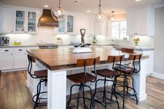 Kitchen. Contemporary Small Kitchens Design Ideas. Varnished Wood Floor Tile Featuring White Stain Wall And White Stain Wooden Kitchen Island Plus Varnished Wood Countertop Along With Varnished Wood Bar Stool With Wrought Iron Legs As Well As White Stain Wooden Kitchen Cabinet