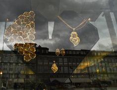 Popular gold jewels and reflections. Seen in Guimarães, Portugal.