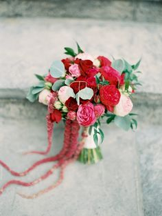 Pink + red cascading bouquet: http://www.stylemepretty.com/2016/01/04/pink-red-watercolor-wedding/ | Photography: When He Found Her - http://whenhefoundher.com/