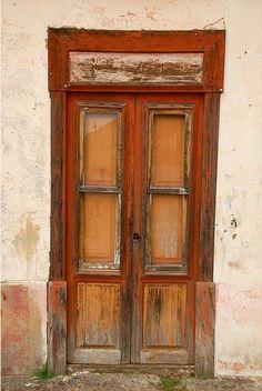 Red door in decay. By Marcel