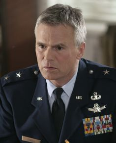 """Gen. Jonathan """"Jack"""" O'Neill. """"Fictional character in the Canadian-American military science fiction television series Stargate SG-1, Stargate Atlantis and Stargate Universe, three science fiction shows about military teams exploring the galaxy via a network of alien transportation devices."""" -Wikipedia"""
