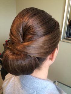 Sleek low chignon bridal updo Charlotte bridal hairstylist www.danaraiabridal.com