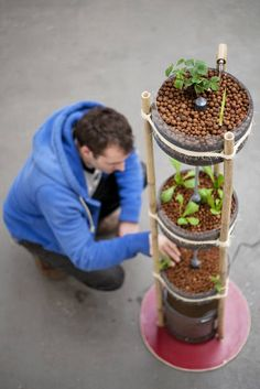 Miniponics, Sustainable fish and plant farm for the living room.  This small aquaponics-installation looks good and is eco-friendly. Plants and fish are cultivated together and help each other survive. The Miniponics consists of not much more than a PET-bottle, bamboo and some rope, and provides households or classrooms with fresh, sustainable food. It's a good-looking addition to your living room, balcony or cafe. Furthermore, it can serve as an interactive learning tool with which to…