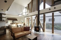 Timber floors and a wood-burning stove in the double-height living room warm up the contemporary interiors.