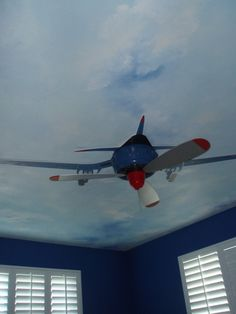 this little boys room soars high, with an airplane theme done by cheri and company