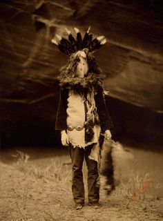 Navajo Dancer masked as Haschelti [Talking God] during the Yeibichai ceremony,1904