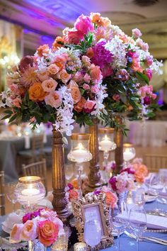Glam #wedding centerpieces - tall, gold vessels with pink + peach floral arrangements {Two Clever Chicks}