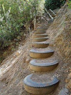 old tires used as stepping stones on a slope