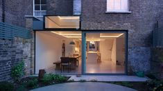 Glazed extension connects refurbished Highbury house with new patio garden