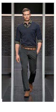 dark trousers, navy sweater over a shirt with brown shoes | business casual