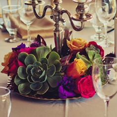 Lovely succulents in the centerpiece. Native to San Diego and perfect for late fall wedding with jewel tones.
