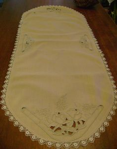Unique Vintage Linen Tablerunner With Hand Embroidery Delicate Lace And Cut Work In Ecru. $20.00, via Etsy.