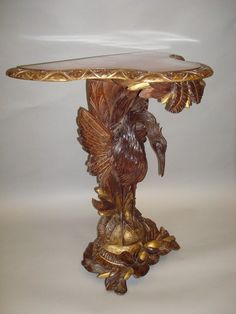 C19th carved walnut and gilt 'heron' console table (Europe)