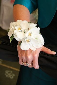 White mini Phalaenopsis Orchids with Turquoise jewel detail in a wrist corsage
