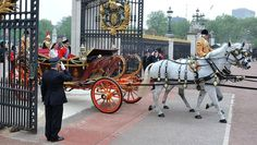 TRH Prince William, Duke of Cambridge and Catherine, Duchess of Cambridge make the journey by carriage procession to Buckingham Palace following their marriage at Westminster Abbey on April 29, 2011 in London, England.