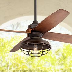 With an oil-rubbed bronze motor, walnut finish wood blades, and a Franklin Park light kit this ceiling fan offers a bold and modern profile.