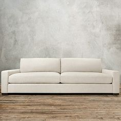 """Handcrafted in America, the Arhaus Remington Deep 108"""" Upholstered 2 Over 2 Sofa With Springs is a sprawling sofa with plenty of room to rest your head."""