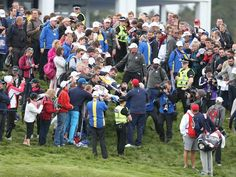 Phil Mickelson is swarmed by fans as he signs autographs.