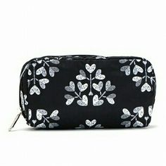 """LeSportsac Cosmetic CaseHP ✨N-W-T✨ Never been used before.   ⏩A sleek zip closure secures this compact cosmetic bag, enlivened with an adorable pattern.  ⏩Zip-around closure.  ⏩Center compartment. ⏩Two inside open pockets.  ⏩Fully lined.  ⏩Polyester. Hand wash.   Measurements (approximate) 8.5'' x 3.75"""" LeSportsac Bags Cosmetic Bags & Cases"""
