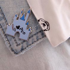 Add a little Disney flair to your wardrobe with this cute castle pin. See all our pins and Disney shirts. Sign up for our newsletter to get 10% off.